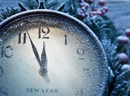 New Year clock powdered with snow. Five to twelve.