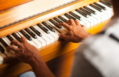 Pianist playing with selective focus on fingers